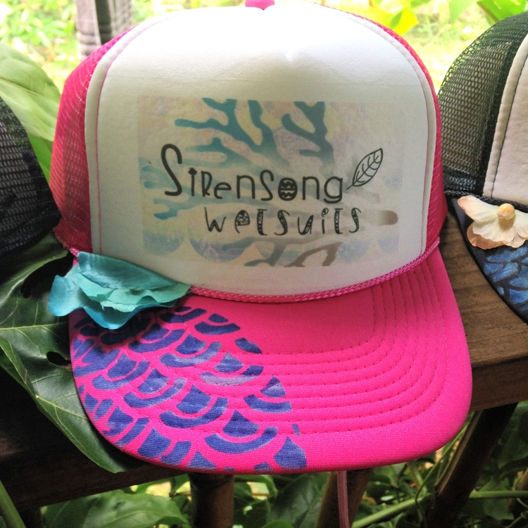 Sirensong Wetsuits' surf hats with leash attached!  Tie it on and never lose your hat in the wind or surf again!