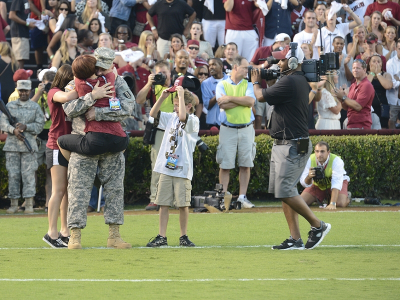 Tammy Faile embraces her husband, Sgt. 1st Class Scott Faile, at Williams-Brice Stadium.  Courtesy of USC Athletics Media Relations