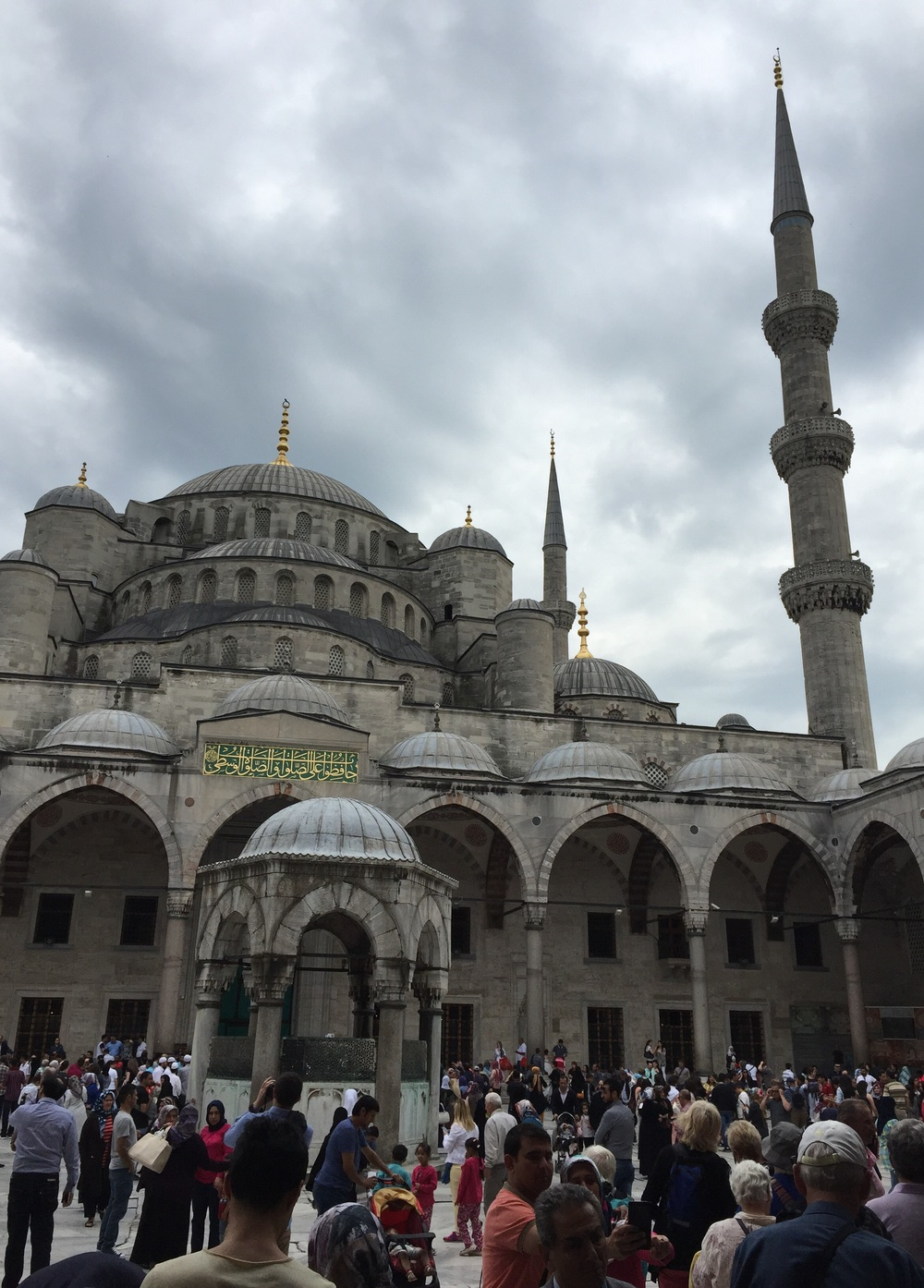 Tourists standing outside the Blue Mosque