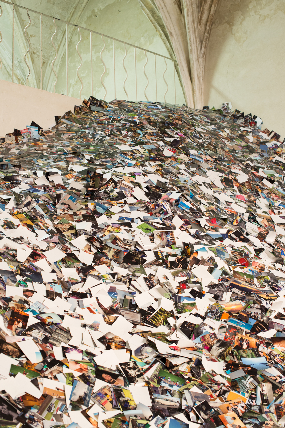 Photograph taken of an installation by  Erik Kessels - 24HRS of Photos  - at the Rencontres d'Arles, 2013