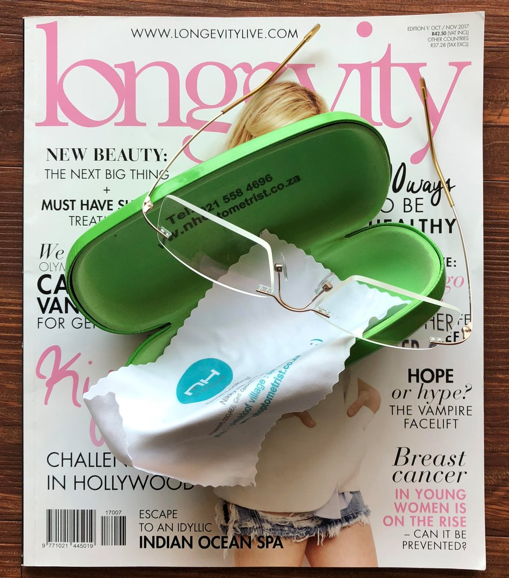 Longevity Magazine & Reading Glasses ©Flyga Twiga LLC