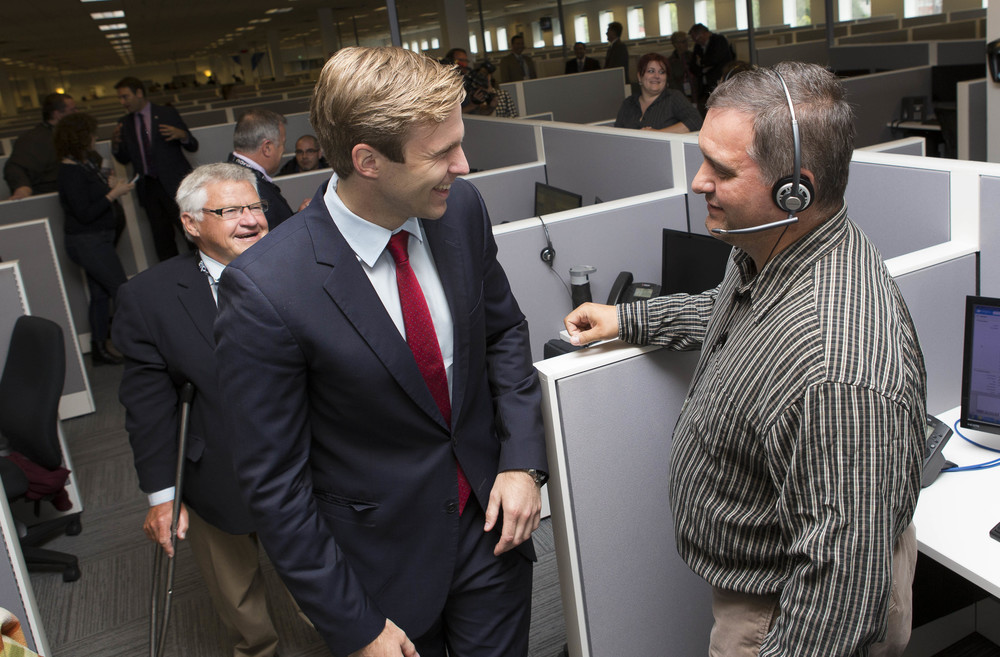 Premier Gallant talking with an employee