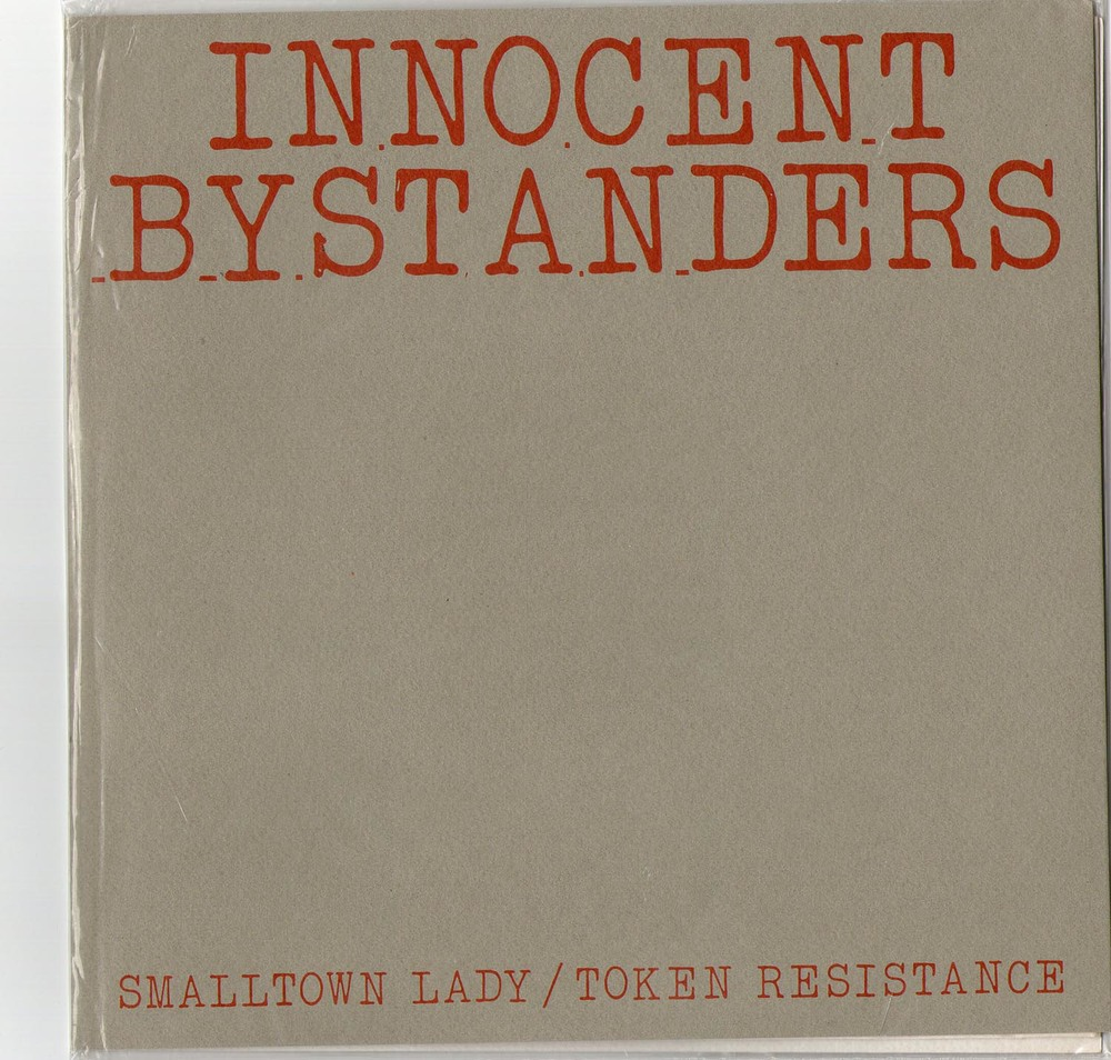 "Grey cover for  Smalltown Lady/Token Resstance  7"" single on the  Thong'n'Dance  label"