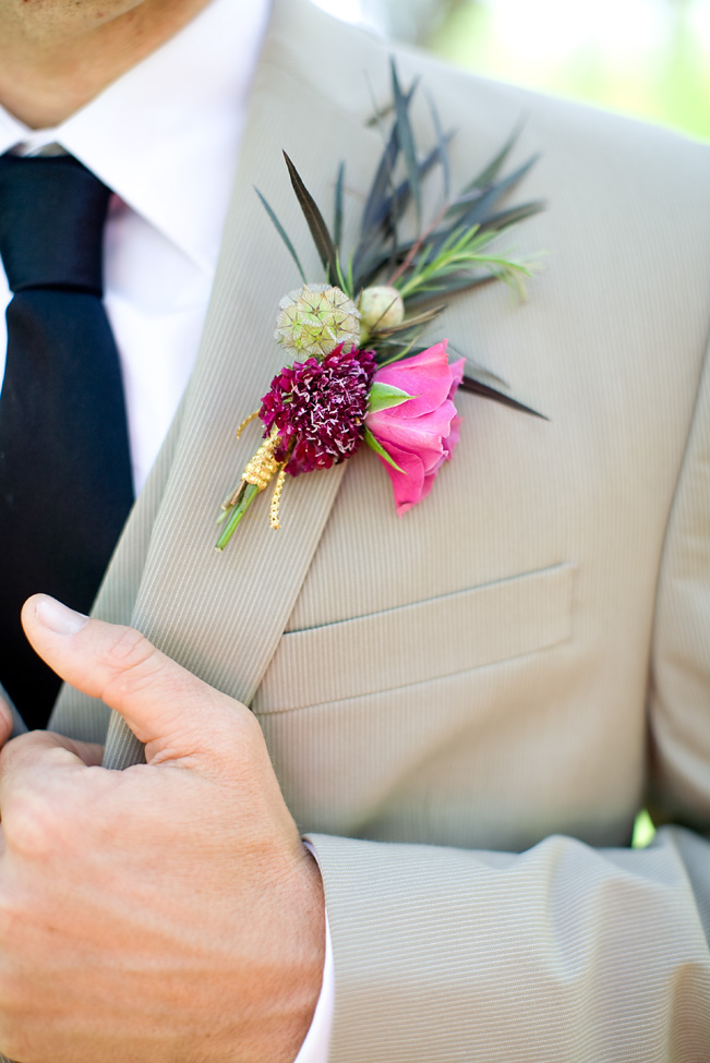 Berry bohemian boutonniere by San Diego florist, Compass Floral.