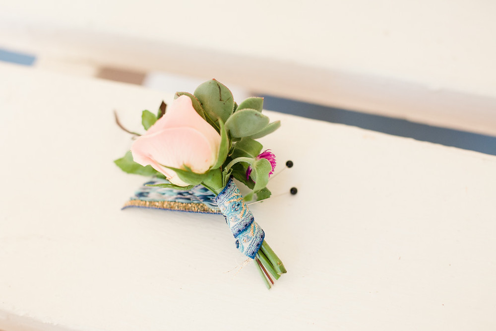 Colorful bohemian boutonnieres by San Diego florist, Compass Floral.