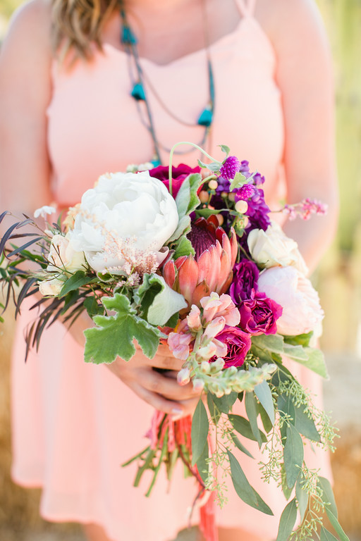 Colorful bohemian   protea bridesmaid bouquets by San Diego florist, Compass Floral.