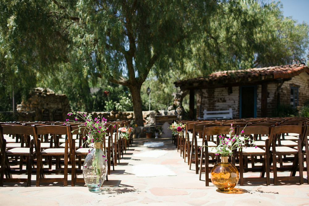 Rustic bohemian wedding ceremony at Leo Carrillo ranch by San Diego florist, Compass Floral.