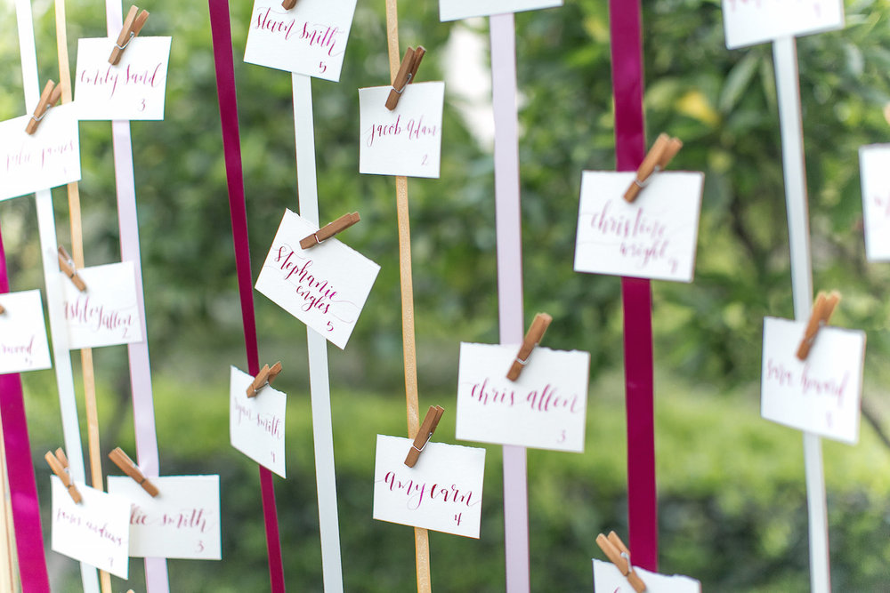 Ribbon wedding escort card display by San Diego Florist, Compass Floral.