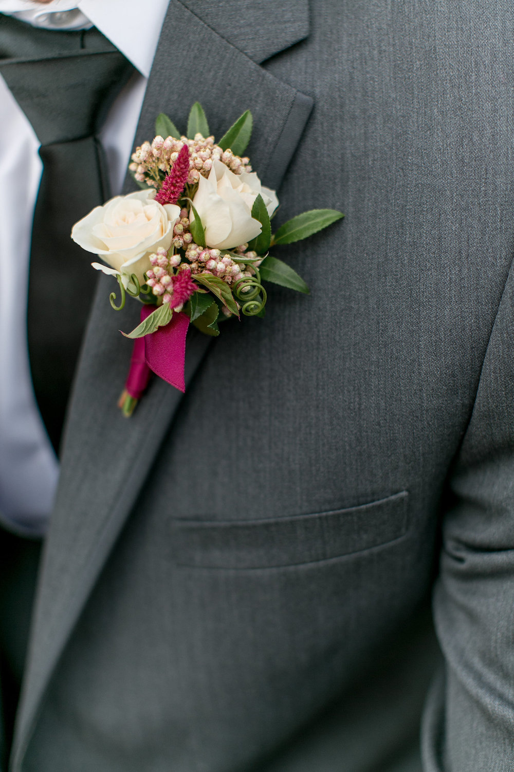 Marsala & blush boutonniere bouquet by San Diego wedding florist, Compass Floral.