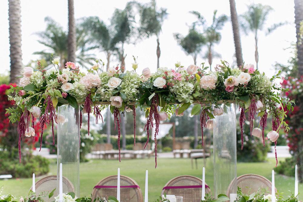 Elevated florals & garland centerpiece by San Diego wedding florist, Compass Floral.
