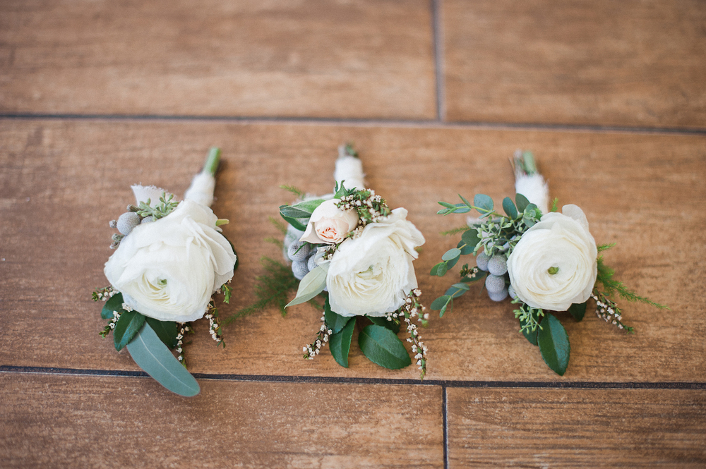 White ranunculus boutonnieres by San Diego wedding florist, Compass Floral.