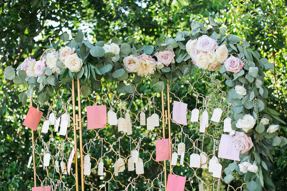 Garland escort card display by San Diego wedding florist, Compass Floral.