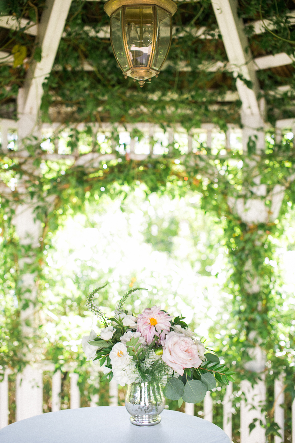 Blush & ivory, garden romantic ceremony decor by San Diego wedding florist, Compass Floral.
