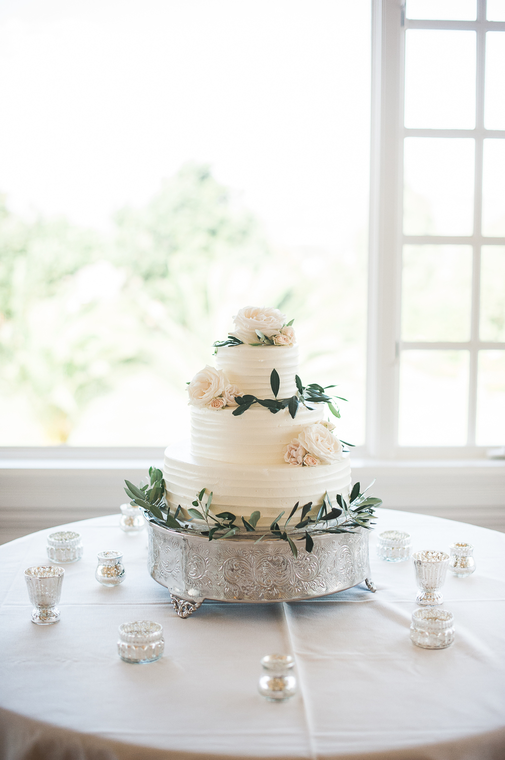 Olive branch cake decorated by San Diego wedding florist, Compass Floral.