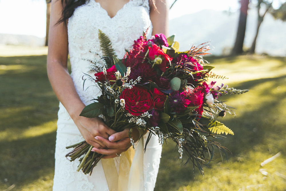 Moody marsala bridal bouquet by San Diego wedding florist, Compass Floral.