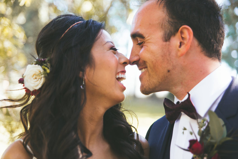 Temecula Creek Inn Moody burgundy & marsala wedding by San Diego wedding florist, Compass Floral.