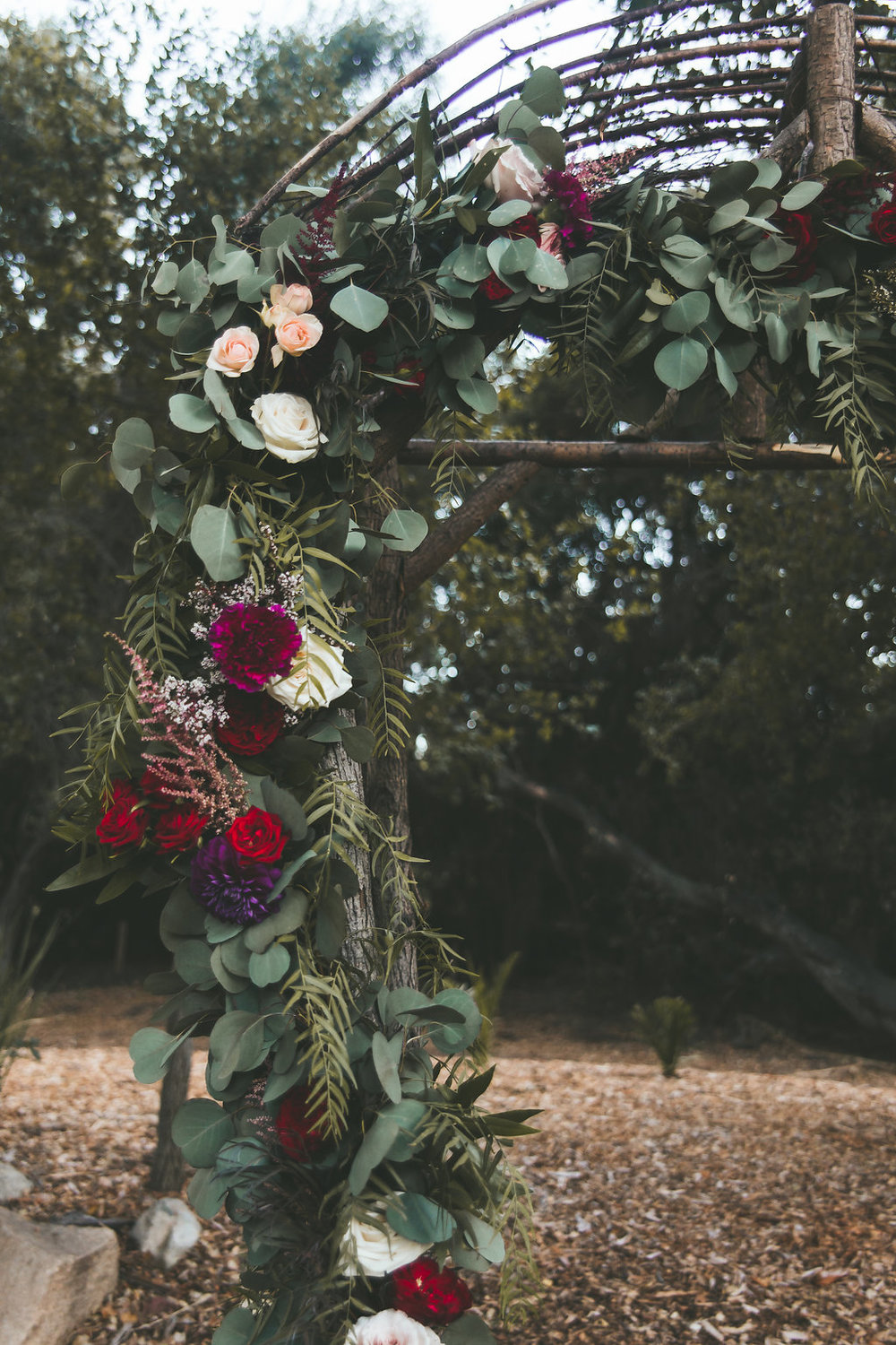 Temecula Creek Inn Moody burgundy &   marsala ceremony garland by San Diego wedding florist, Compass Floral.
