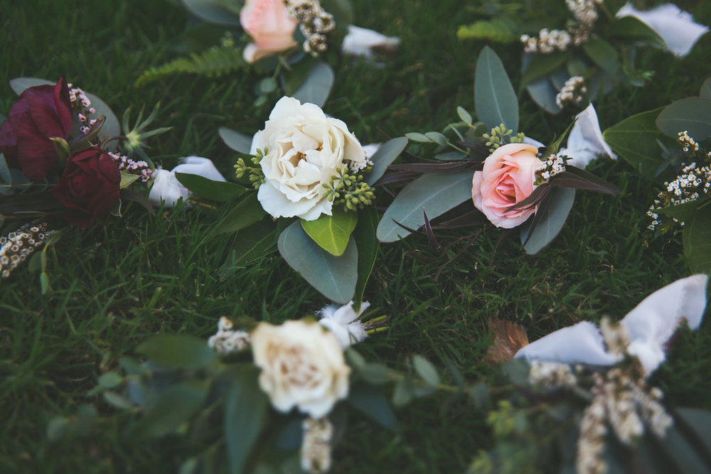 Burgundy, marsala, blush & ivory boutonnieres by San Diego wedding florist, Compass Floral.