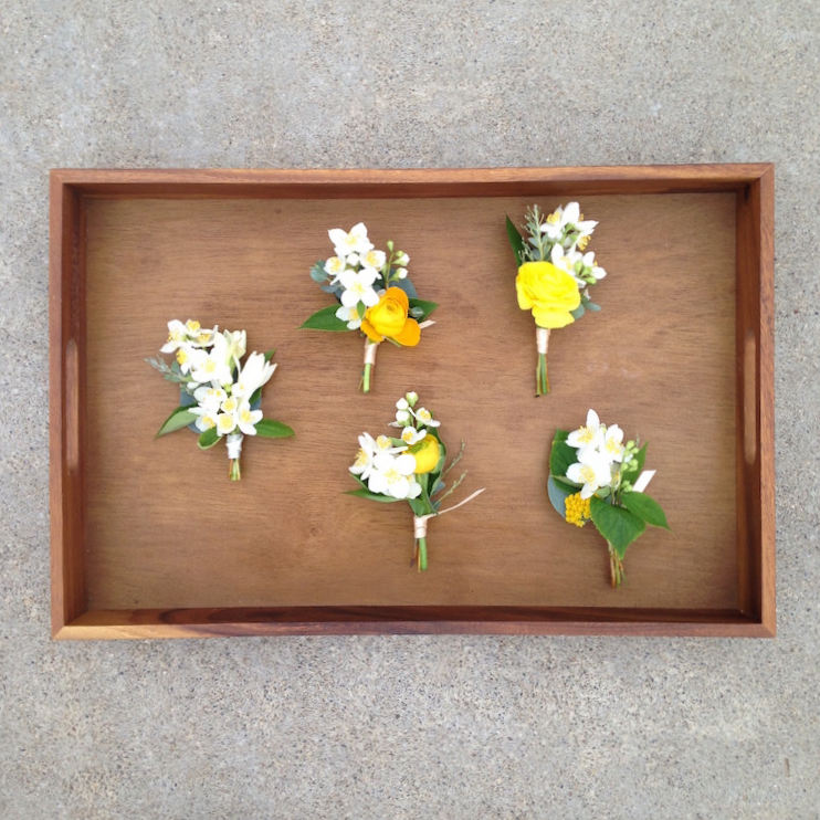 White & citrus raging garden party centerpieces by San Diego wedding florist, Compass Floral.