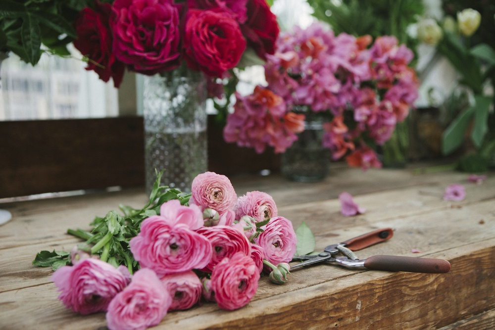 Pink ranunculus, garden roses & bougainvilleaby Compass Floral.  Photography by Ashley Williams.