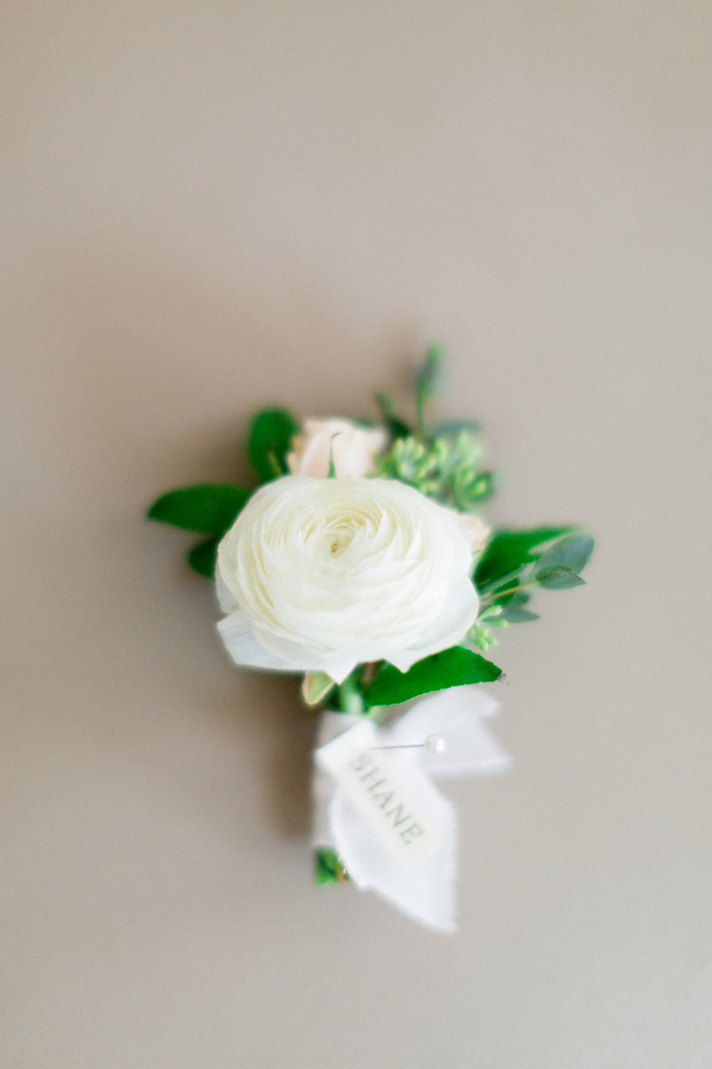 White ranunculus boutonniere by San Diego wedding florist, Compass Floral.