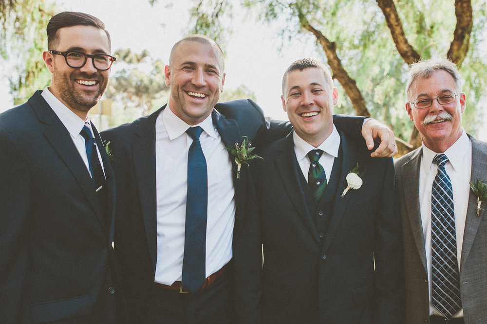Groom and groomsmen boutonnieres by San Diego wedding florist, Compass Floral.