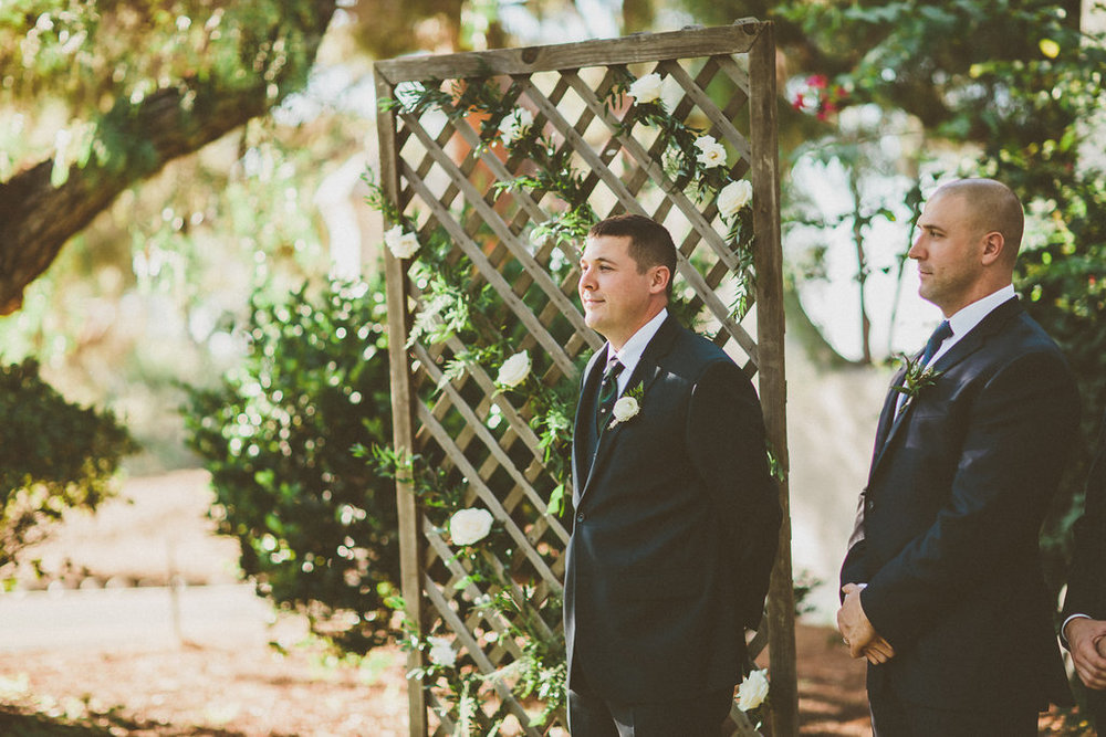 Green and white wedding ceremony by San Diego wedding florist, Compass Floral.