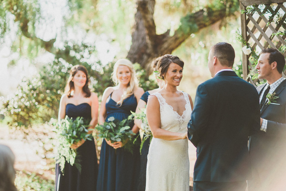 Green and white ceremony by San Diego wedding florist, Compass Floral.