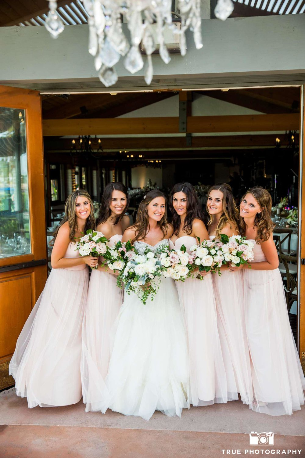 Blush & ivory bridesmaid bouquets by San Diego wedding florist, Compass Floral.