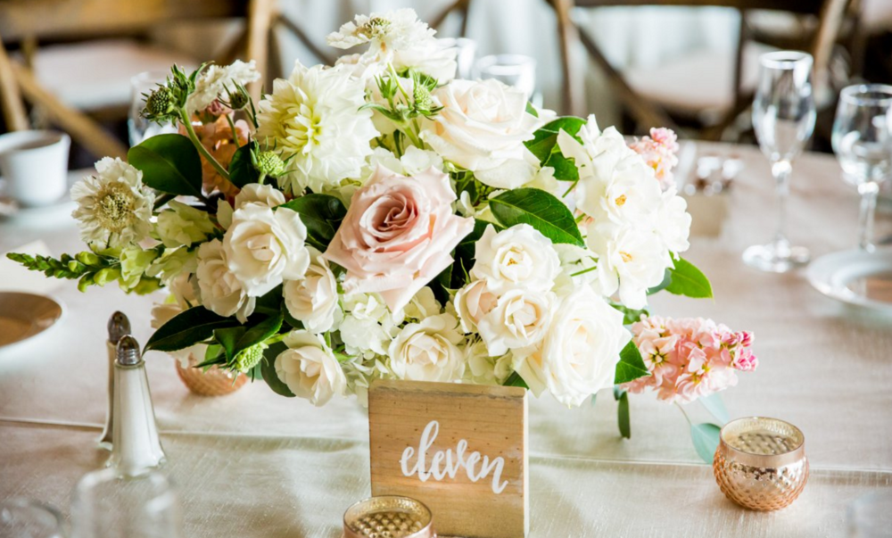 Garden romantic ivory & blush wedding centerpiece by San Diego wedding florist, Compass Floral.