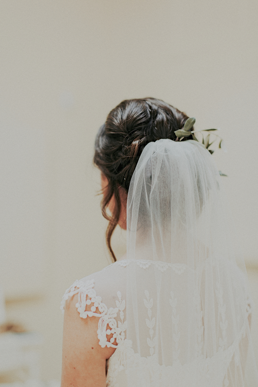 Olive branch hair flowers by San Diego wedding florist, Compass Floral.