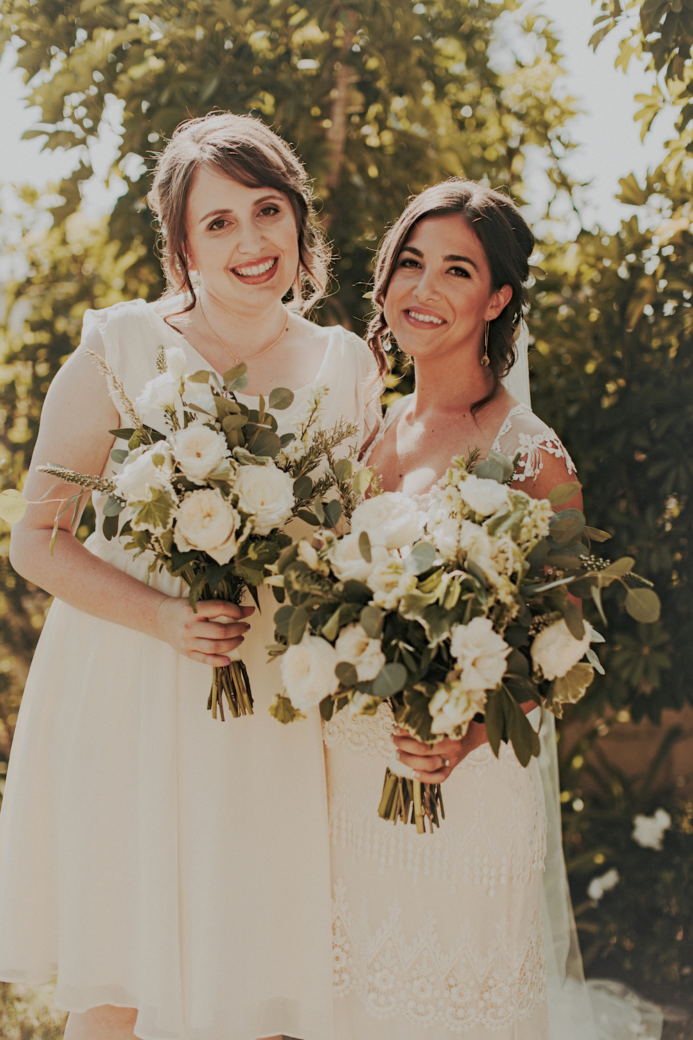 Green and white wedding bouquets  by San Diego wedding florist, Compass Floral.