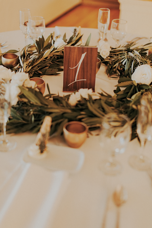 Herb wreathe centerpiece by San Diego wedding florist, Compass Floral.