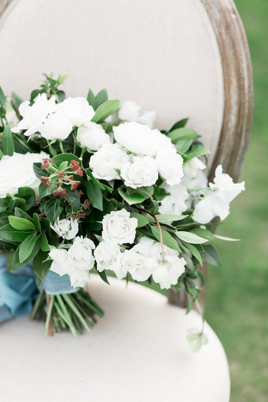 Elegant white bridal bouquet by Compass Floral | Rancho Valencia, Rancho Santa Fe.