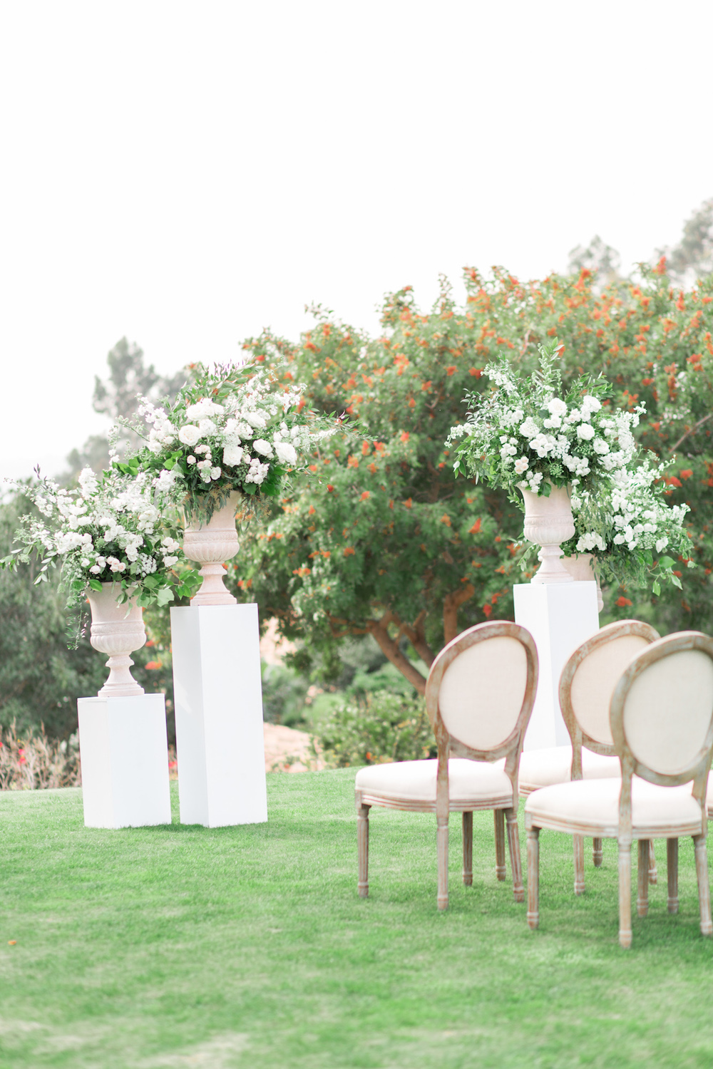 Garden romantic white ceremony pedestal florals| Rancho Valencia Weddings | Rancho Santa Fe | Compass Floral | Wedding Florist in San Diego and Southern California | Cavin Elizabeth Photography