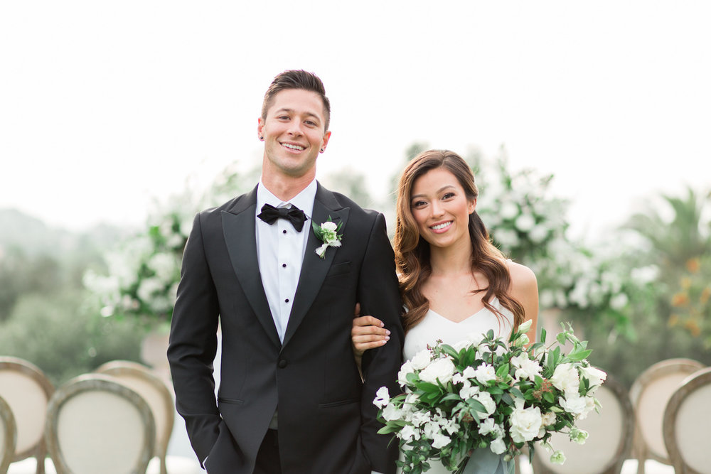 Classic, modern, elegant bride and groom with bridal bouquet by Compass Floral | Rancho Valencia, Rancho Santa Fe.