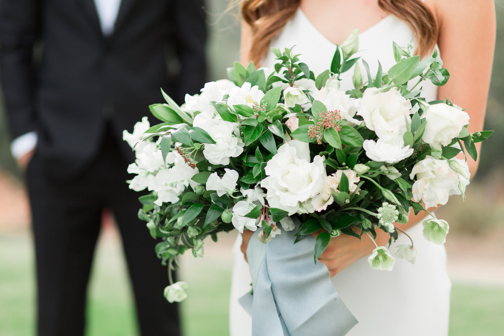 Elegant white bridal bouquet with trailing blue silk ribbons by Compass Floral | Rancho Valencia, Rancho Santa Fe.