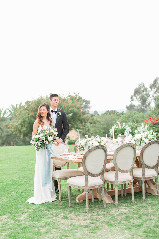 Bride & groom portrait with bouquet by Compass Floral | Rancho Valencia, Rancho Santa Fe.