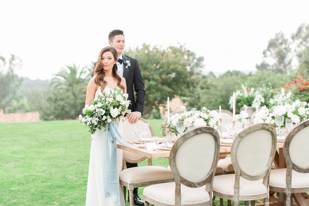 Ivory & green wedding reception by Compass Floral | Rancho Valencia, Rancho Santa Fe.