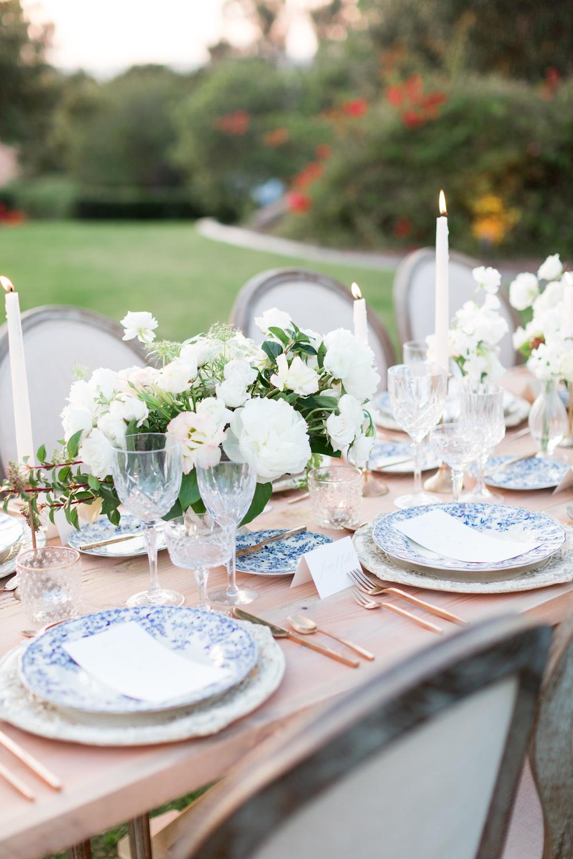 Elegant ivory & green wedding centerpiece by Compass Floral | Rancho Valencia, Rancho Santa Fe.