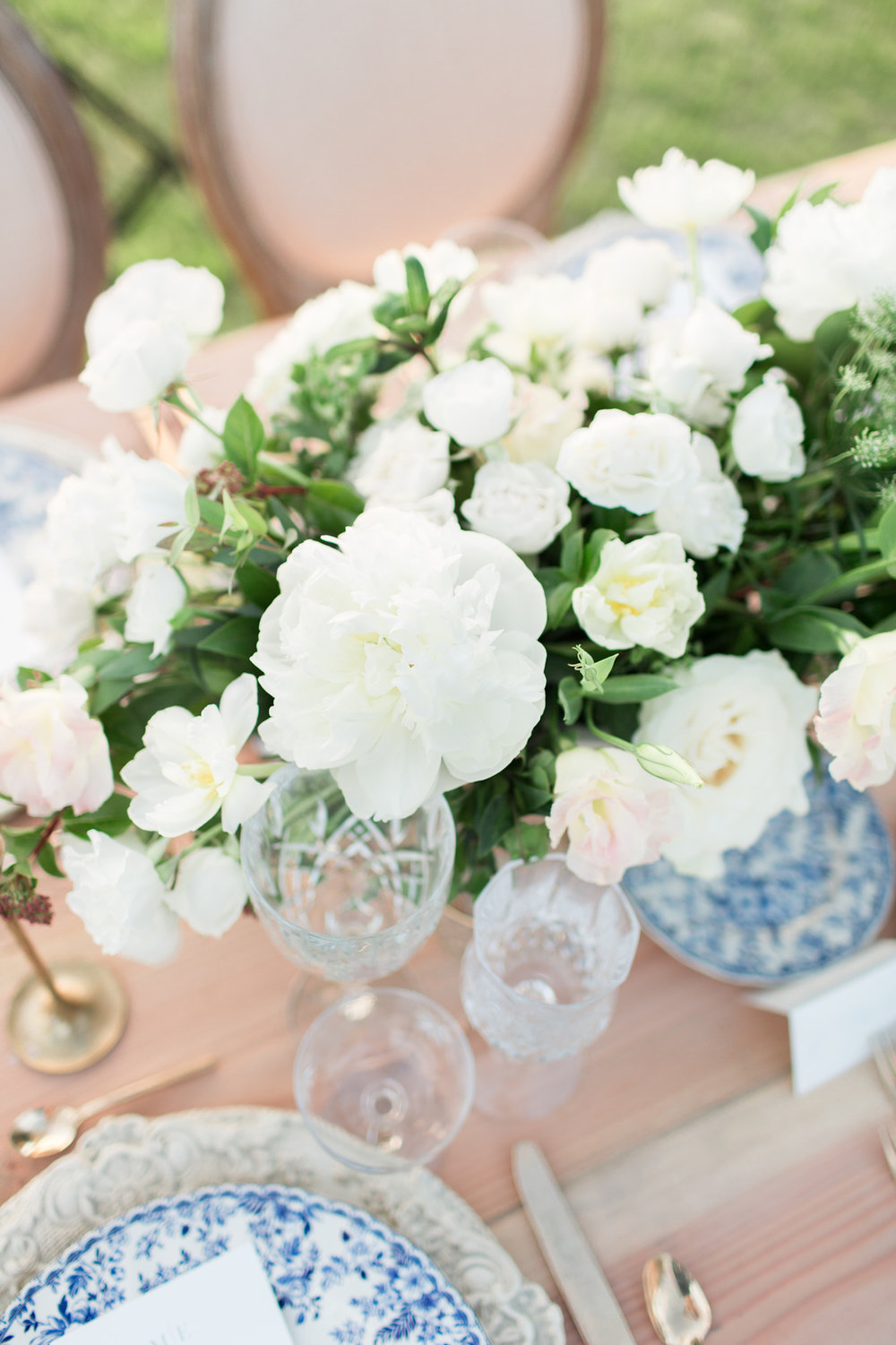 White peony & garden rose centerpiece with blue chinoiserie place settings by Compass Floral | Rancho Valencia, Rancho Santa Fe.