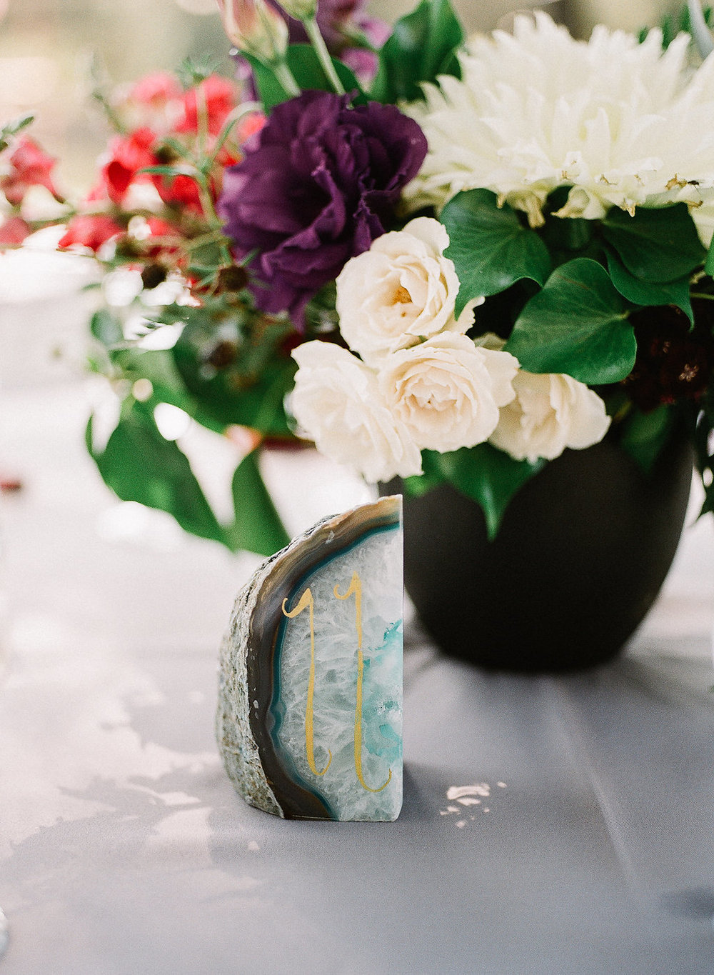 Geode table number with jewel tone centerpiece by Compass Floral | Fallbrook Treehouse, Fallbrook