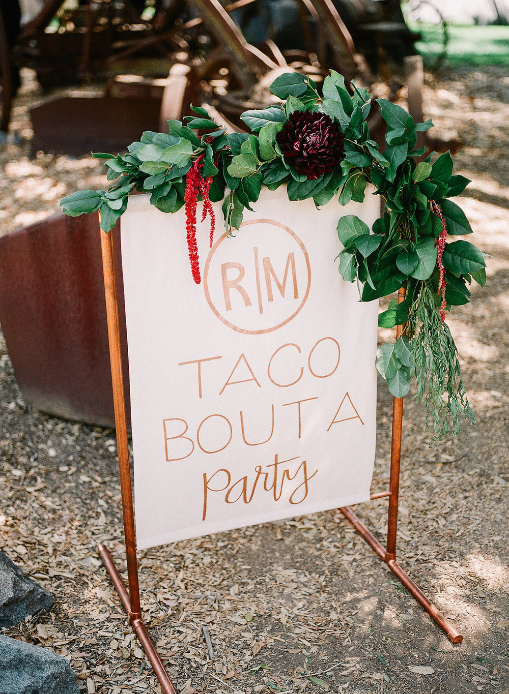 Monogrammed wedding taco sign with floral garland by Compass Floral | Fallbrook Treehouse, Fallbrook
