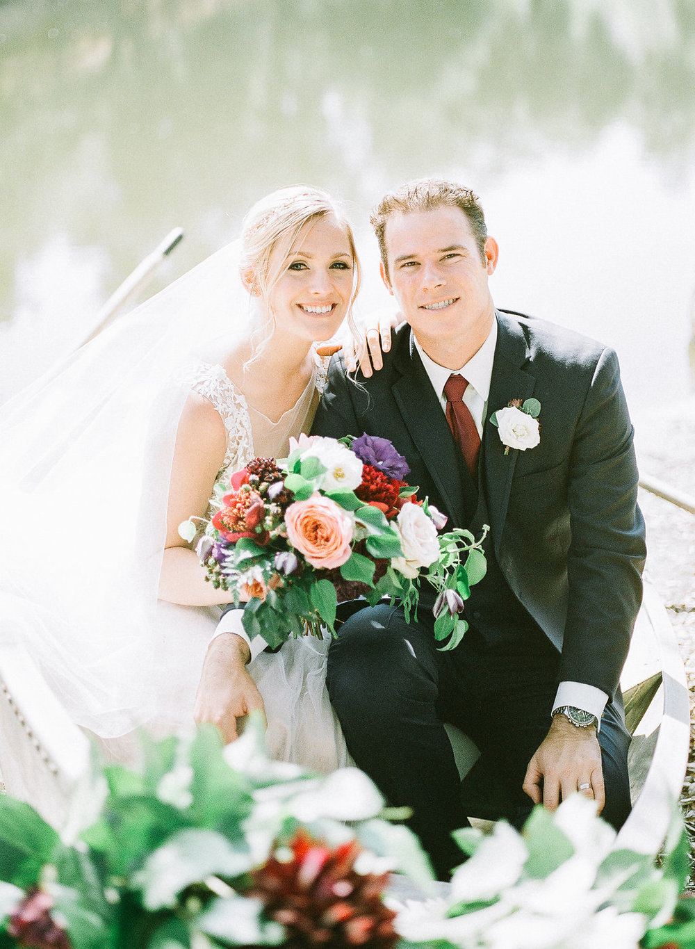 Lake portrait of bride and groom with florals by Compass Floral | Fallbrook Treehouse, Fallbrook