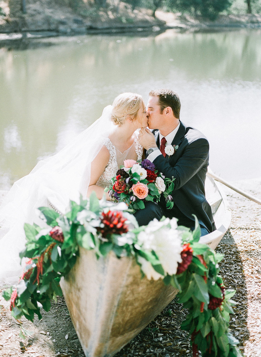 Wedding rowboat with floral garland by Compass Floral | Fallbrook Treehouse, Fallbrook