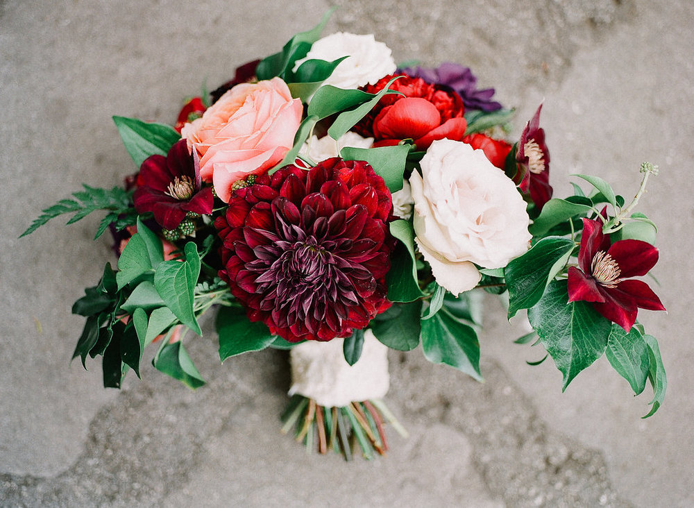 Romantic, jewel tone bridal bouquet of romantic antike garden roses, quicksand roses, dahlias, peonies and clematis by Compass Floral | Fallbrook Treehouse, Fallbrook
