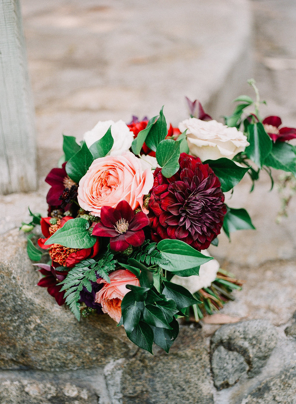 Romantic, jewel tone bridal bouquet of romantic antike garden roses, dahlias and clematis by Compass Floral | Fallbrook Treehouse, Fallbrook