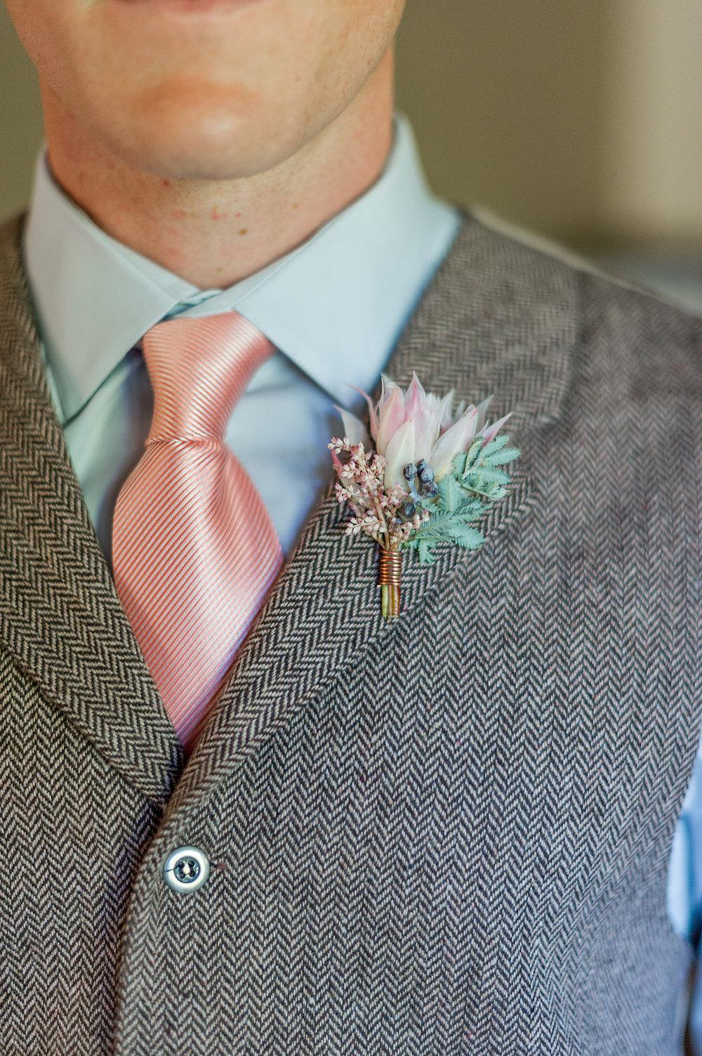 Blushing bride protea boutonniere by Compass Floral | Estancia Hotel & Spa, La Jolla.