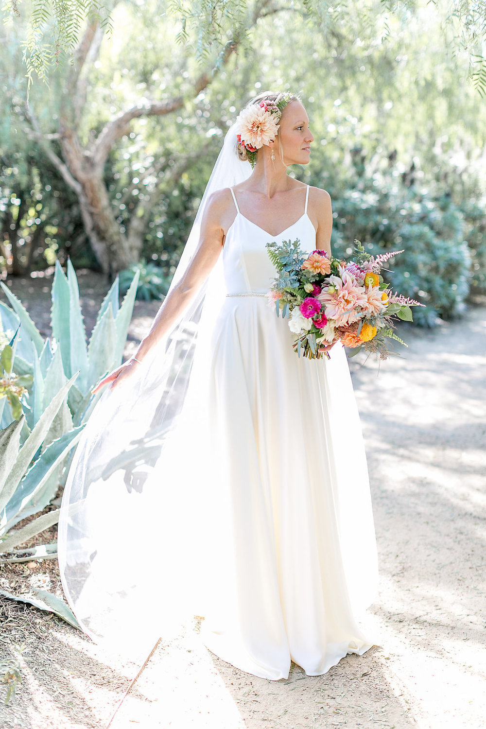 Desert bohemian bride with bouquet and hair flowers by Compass Floral | Estancia Hotel & Spa, La Jolla.