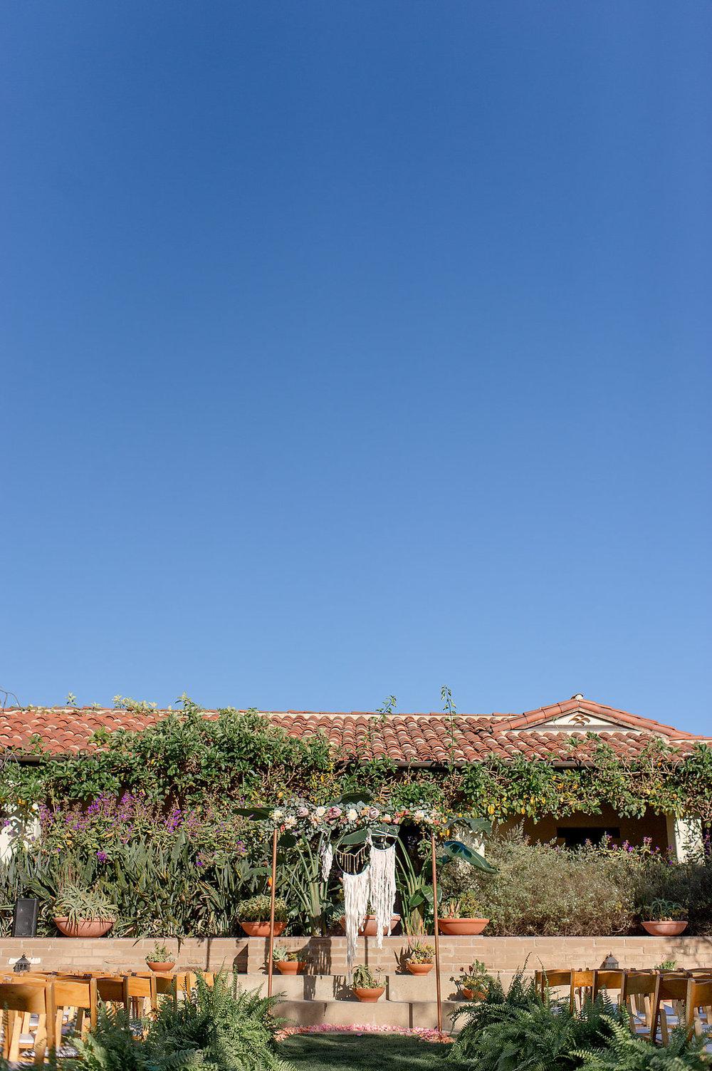 Desert bohemian wedding ceremony by Compass Floral | Estancia Hotel & Spa, La Jolla.